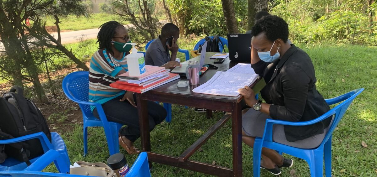 METS staff interacting with Mildmay's Elizabeth during the DREAMS Data Audit at Kalule in Nyimbwa Subcounty